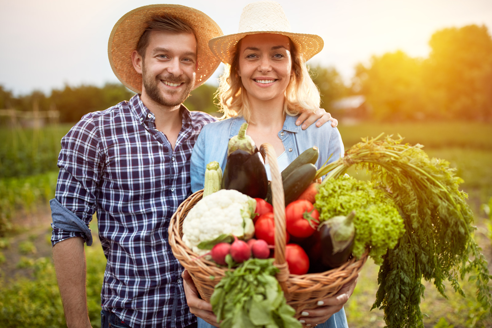 farmer-couple-with-basket-of-vegetables
